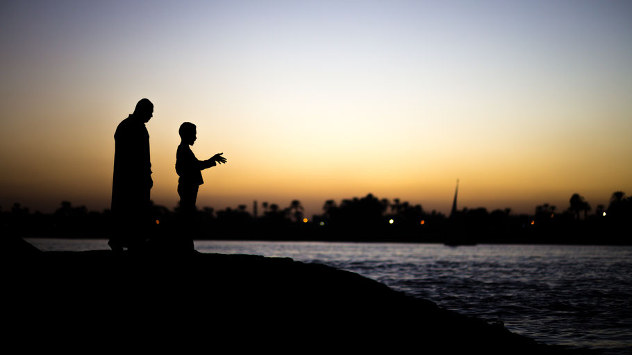 Father and son silhouette at Nile river, Luxor