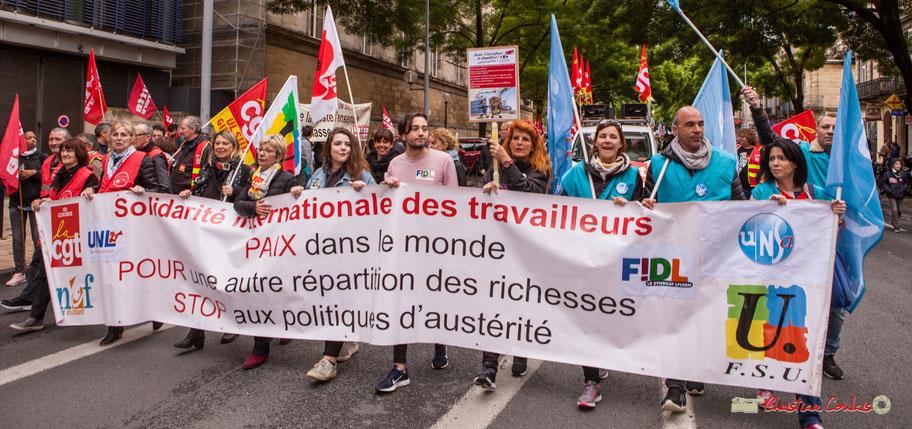 """Solidarité internationale des travailleurs. """"Pour la paix dans le monde, pour une autre répartition des richesses, stop aux politiques d'austérité"""". Fête du travail, 1er mai 2018, Bordeaux"""