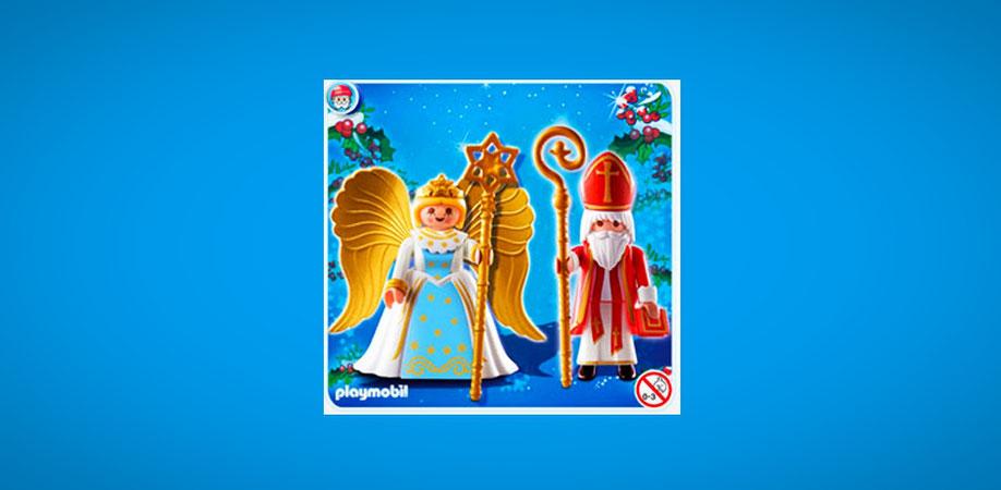 © Screenshot: playmobil.de Eine kleine Nikolaus-Playmobilfigur mit roter Mitra und goldenem Bischofsstab steht neben einem Playmobil-Engel mit weißem Kleid und goldenen Flügeln.
