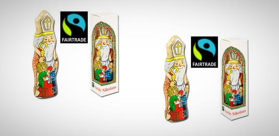 Der Schokonikolaus mit goldener Mitra und Bischofsstab, vor ihm sind zwei Kinder abgebildet. Der Junge an der linken Seite wird vom Nikolaus umarmt und hält einen roten Apfel in der Hand. Das Mädchen daneben blickt den Nikolaus erwartungsvoll an.
