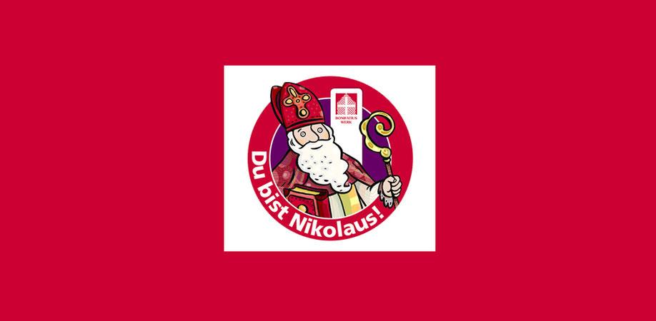 """In einem roten Kreis, auf dem steht: """"Du bist Nikolaus!"""" ist ein Bischof Nikolaus mit Mitra und Bischofsstab zu sehen."""