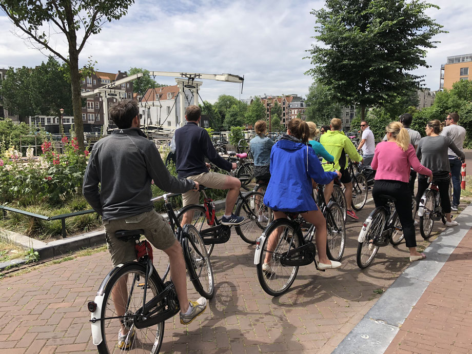 A group of cyclists on a bike tour in Amsterdam