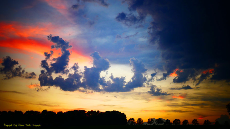 Wölken, Sonnenuntergang