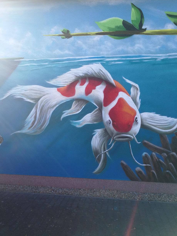 Fassadenkunst in Fürstenwalde Graffiti Firmenwerbung Logo Tiermotiv