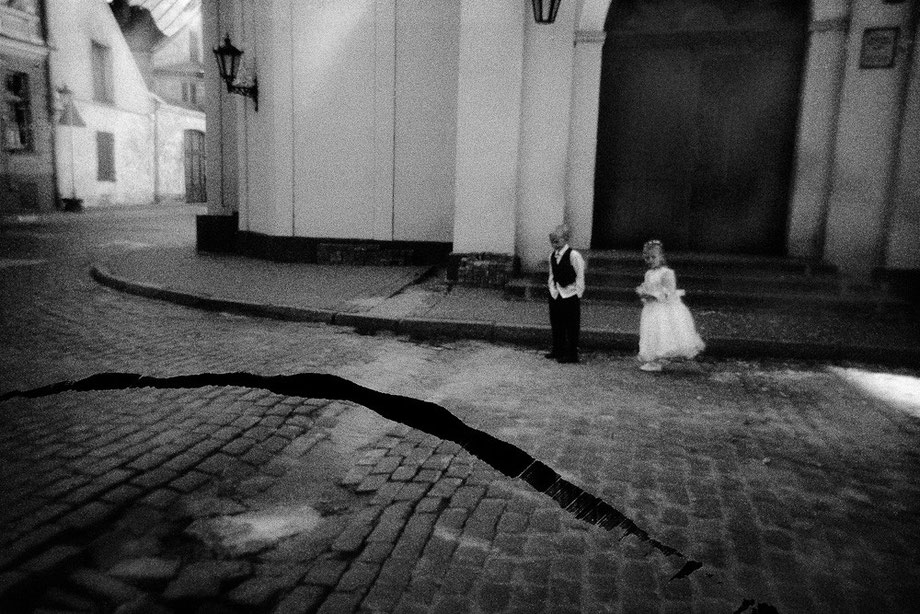 LATVIA / Riga / From the book 'Auftakt'. Wedding children near the church. The crack is a scratch on negative, 2006
