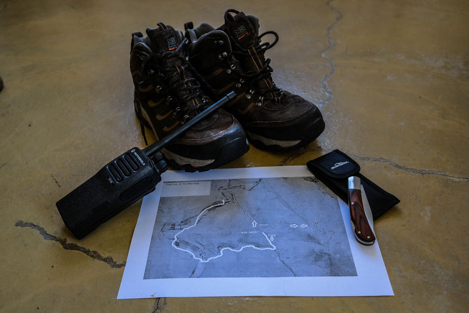 Prepared some stuff to take with me while hiking, climbing the mountain: good shoes, a knife, a map and a radio. South Africa