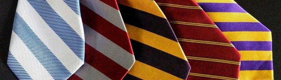 Clubkrawatten in verschiedenen Farben und Streifenkombinationen von Joint Colours