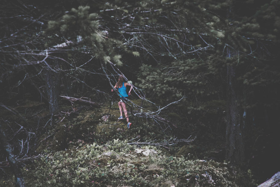 Woman running through forest Minimalist Biohacker approach to strength and stamina