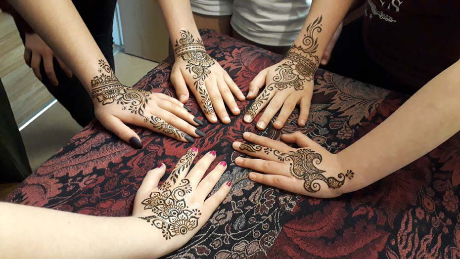 Teenagers and children enjoy a special henna party for a birthday. Birthdays and celebrations in devon and Cornwall