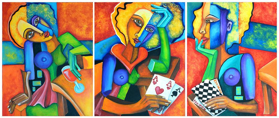 drei Frauen sitzen zusammen und spielen Karten