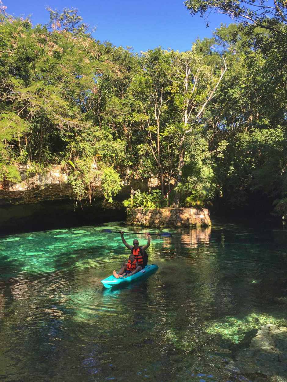 Kantun-chi ecopark cenotes in Mexico kayak with a toddler