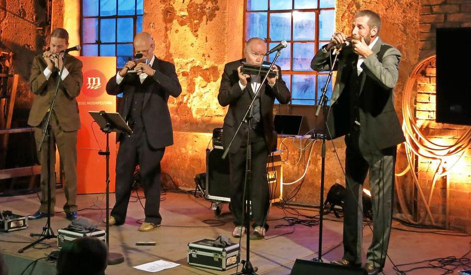 Das finnische Mundharmonikaquartett Sväng bei seinem Auftritt in der Kulturgießerei in Saarburg. FOTO: Christoph Strouvelle