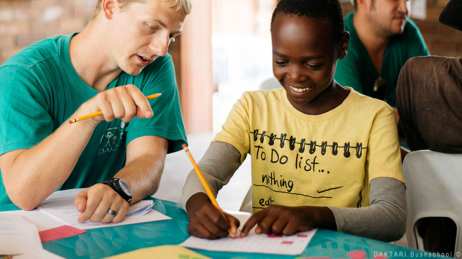 Volunteer teaching African children