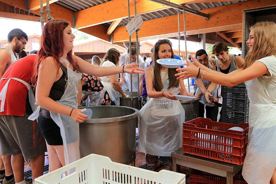 Young pilgrims doing the dishes. Taize ecumenical community. Bourgogne.