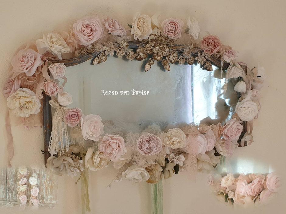 Guirlandes van papieren rozen om spiegel. Op maat gemaakteguirlandes.