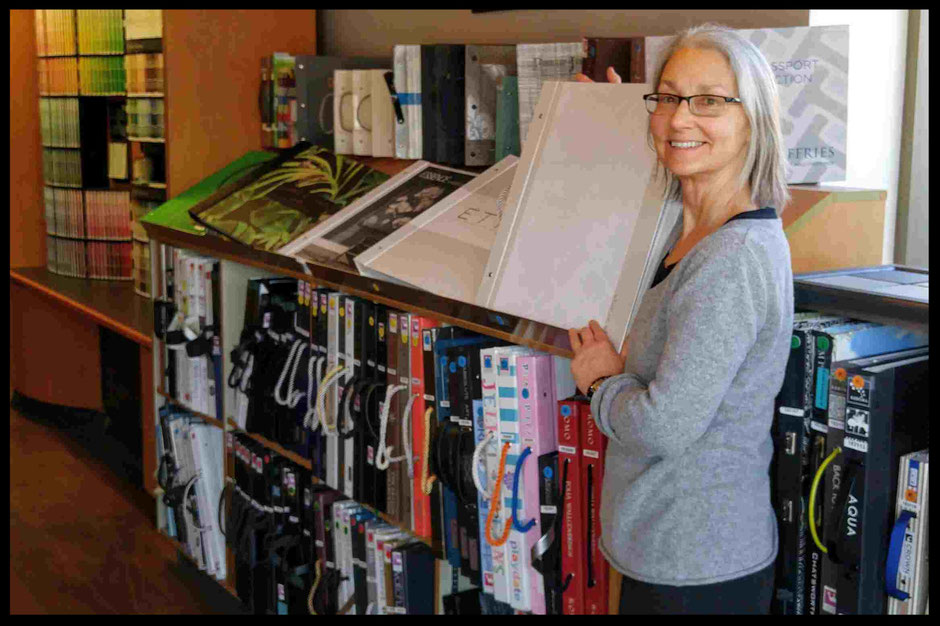 Manager Judith at Upper Village Paint & Wallpaper's Wallpaper books