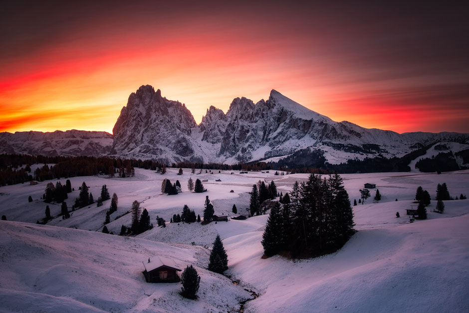 Alpi di Siusi at sunrise in early November after a snowfall