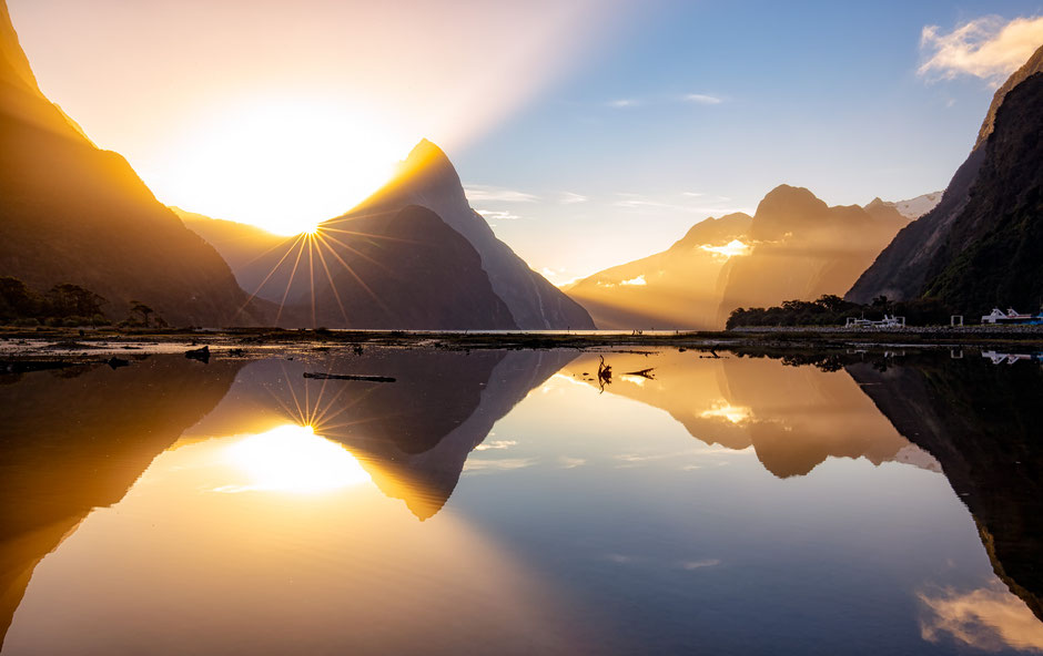 Mitre Peak and Milford Sound in the afternoon autumn sun. Guide to visiting Milford Sound