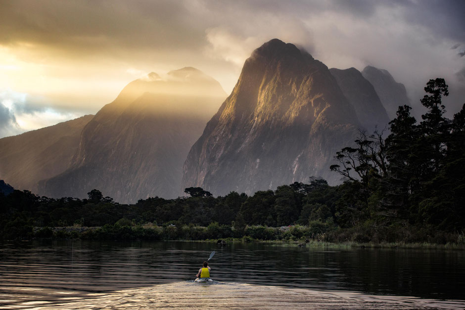 Kayaking at sunset in Milford Sound