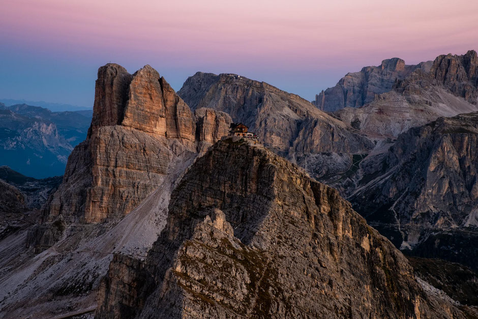 Cotton candy skies at dawn with Mount Averau and Rifugio Nuvolau in the Italian Dolomites