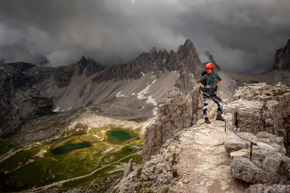 A climber on the summit of Torre di Toblin after completing her first via ferrata