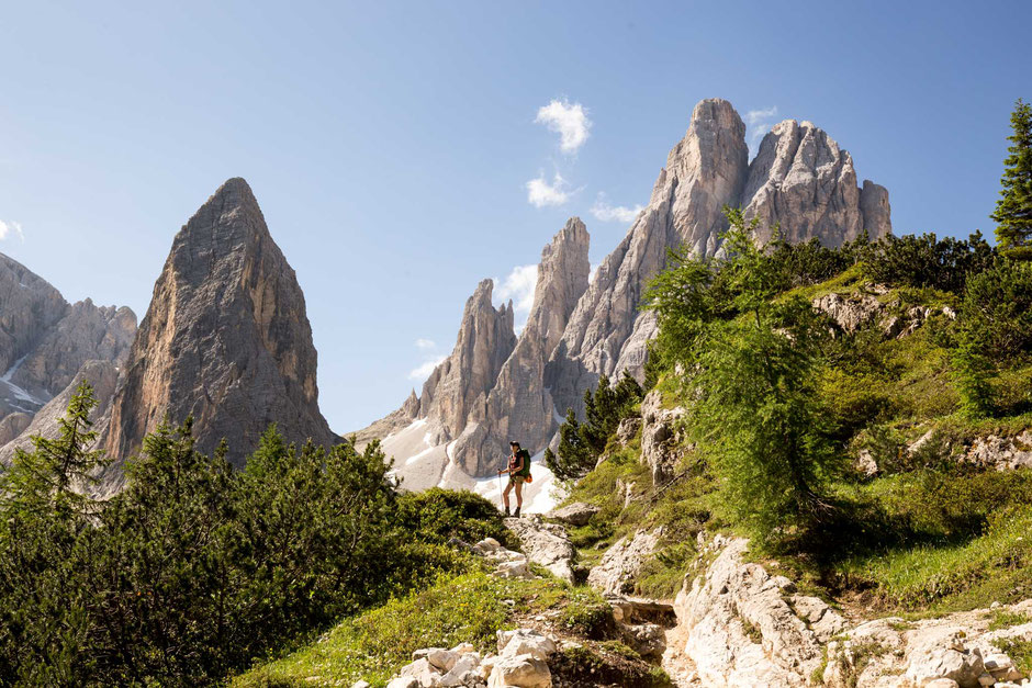 A hiker on a trail in the Tre Cime National Park in the Italian Dolomites