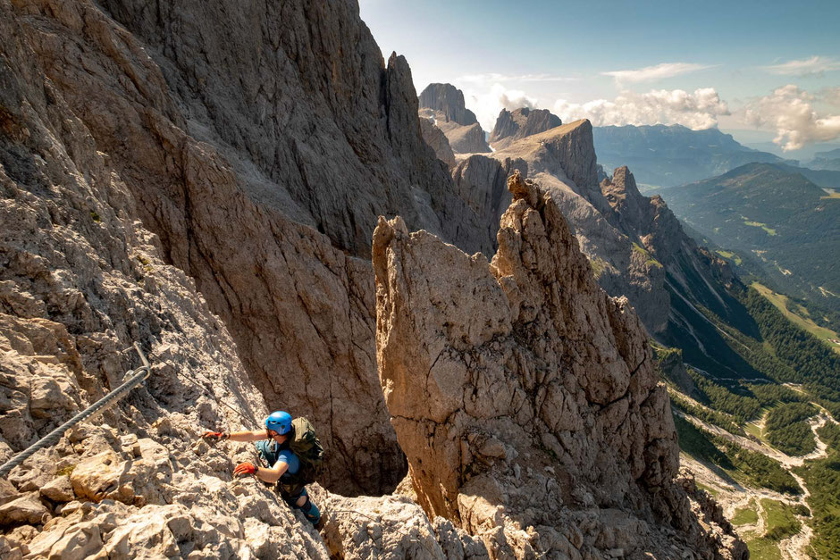 Climber on the top section of the via ferrata Bolver Lugli - one of the advanced via ferratas in the Italian Dolomites