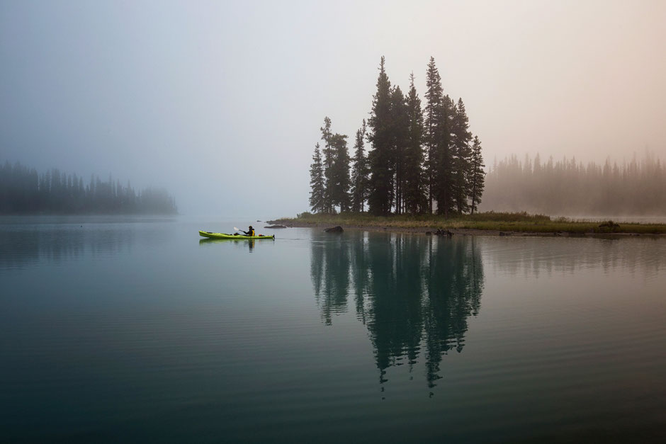 Kayaking near spirit island. Guide to multi day paddling trip on Maligne lake