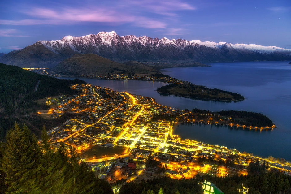 Queenstown at dusk. The Remarkables mountain range can be seen in the distance