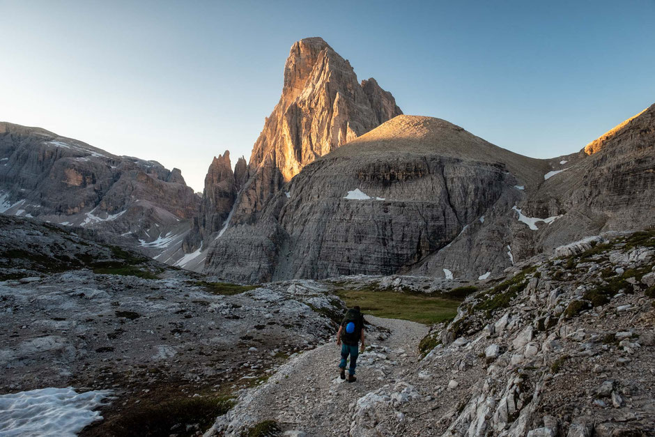 Backpacking across the Tre Cime National Park in the Italian Dolomites with Croda Dei Toni at sunrise.