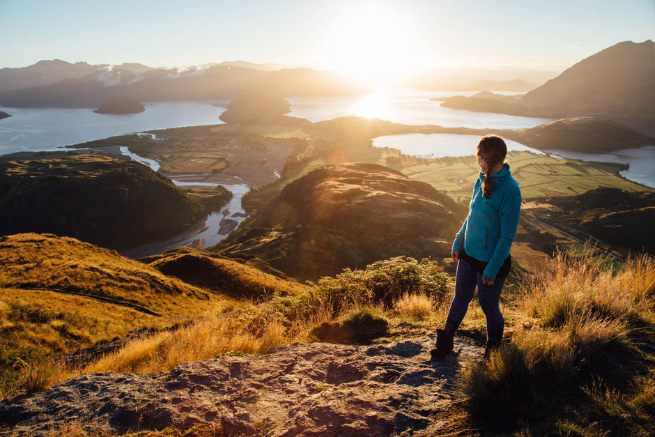 Hiker on the top of Rocky Mountain, one of the best day hikes in Wanaka in New Zealand