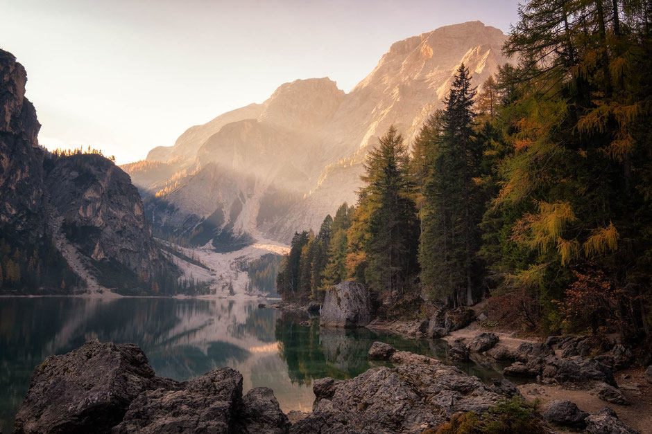 Early morning sunrays at Lago di Braies in the Italian Dolomites
