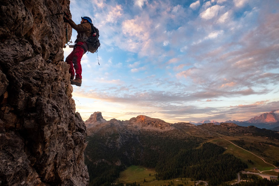 Climber at dawn along the via ferrata Degli Alpini Al Col Dei Bos near Cortina D'Ampezzo in the Italian Dolomites