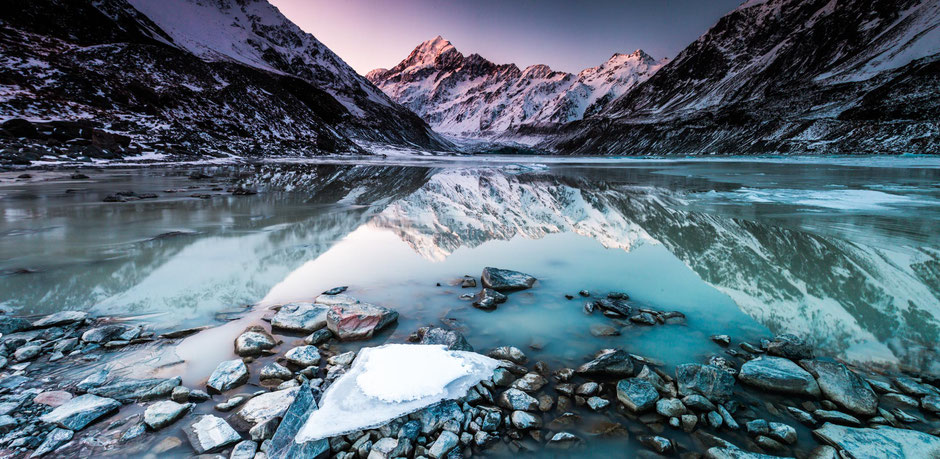 Mount Cook reflecting in the Hooker Glacier Lake. One week road trip itinerary around New Zealand