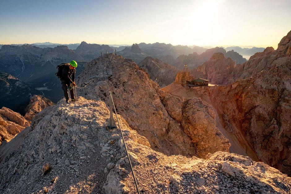 A person hiking along the ridgeline, part of the traverse of the via ferrata Ivano Dibona