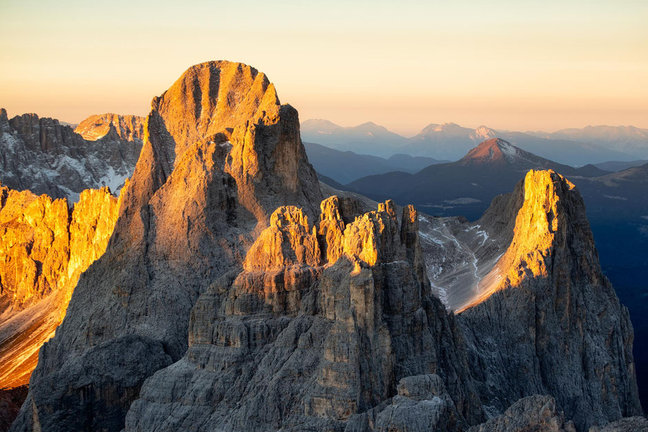 The view of the Vajolet Towers at sunrise from the summit of Monte Catinaccio in the Rosengarten Nature Park.