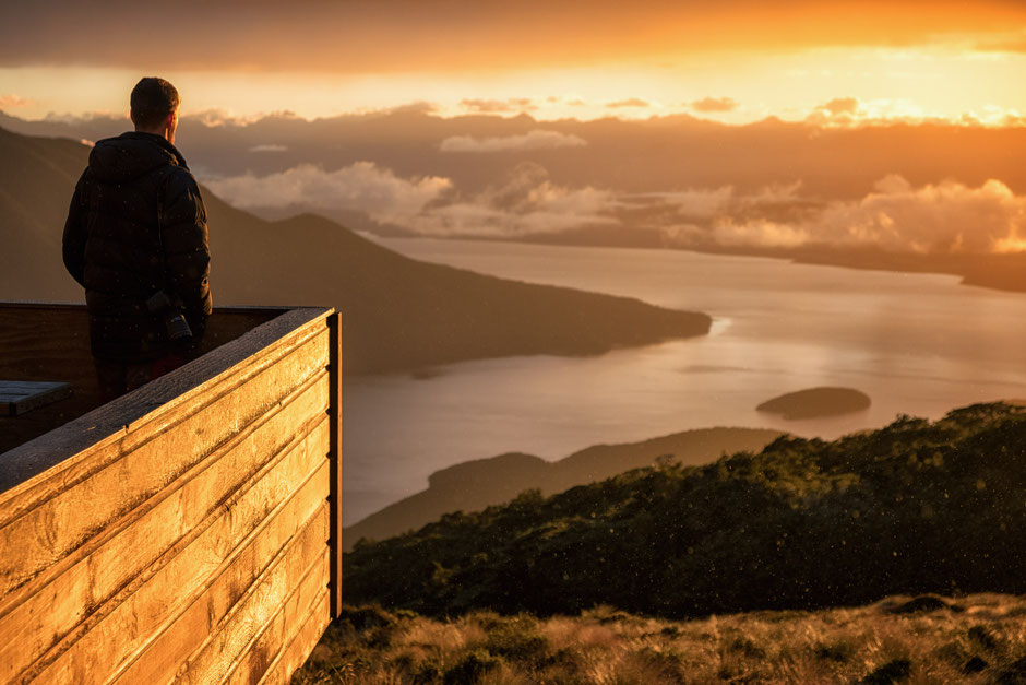 A sunrise from the Luxmore Hut on the Kepler Track in New Zealand