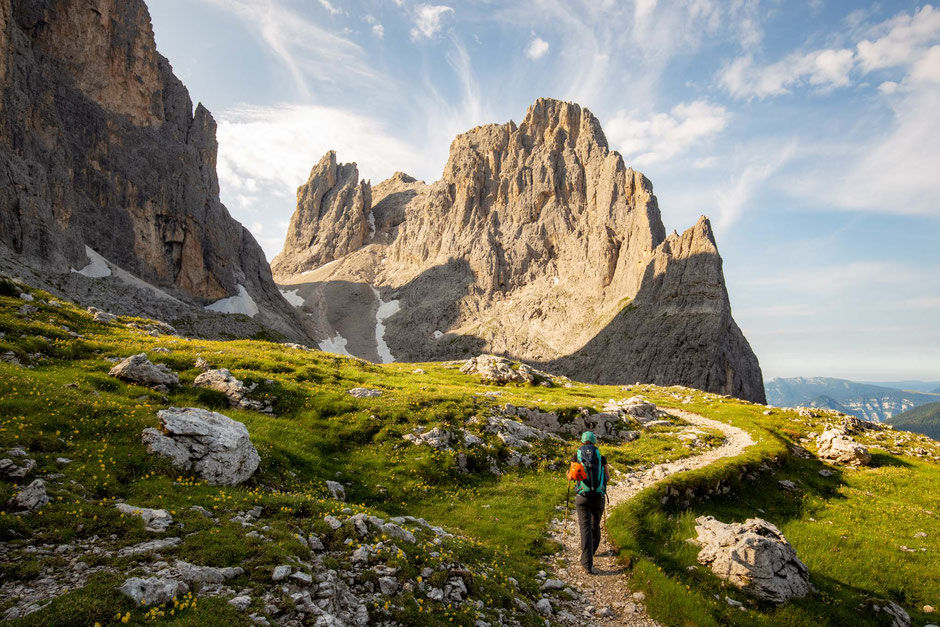 Hiking towards Passo di Ball with Cima Di Val Roda as the backdrop. Third day of the traverse across the Pale di San Martino Group in the Italian Dolomites