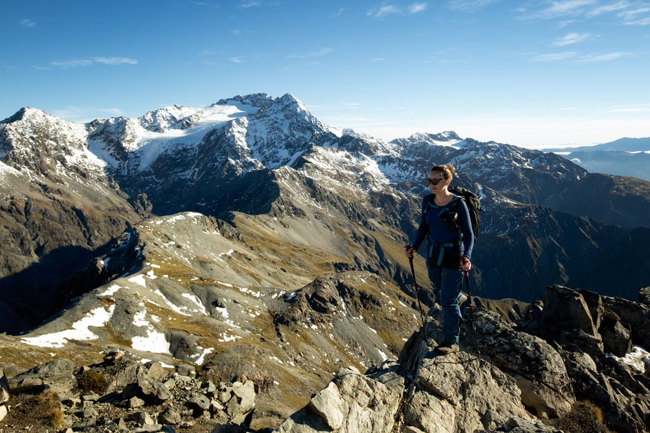 Hiker on the summit of Avalanche Peak in Arthur's Pass National Park in New Zealand.