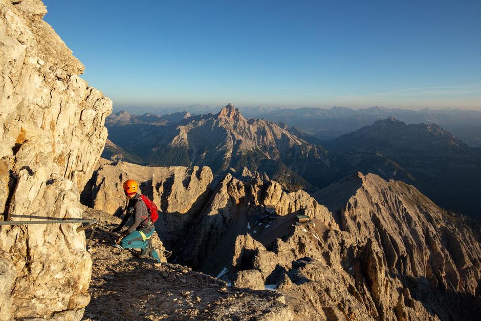 A climber on the via ferrata Marino Bianchi in the Italian Dolomites