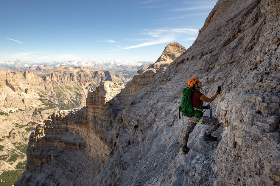 Climber amongst the 'amphitheater of rock' along the via ferrata Giovanni Lipella to the summit of Tofana di Rozes in the Italian Dolomites