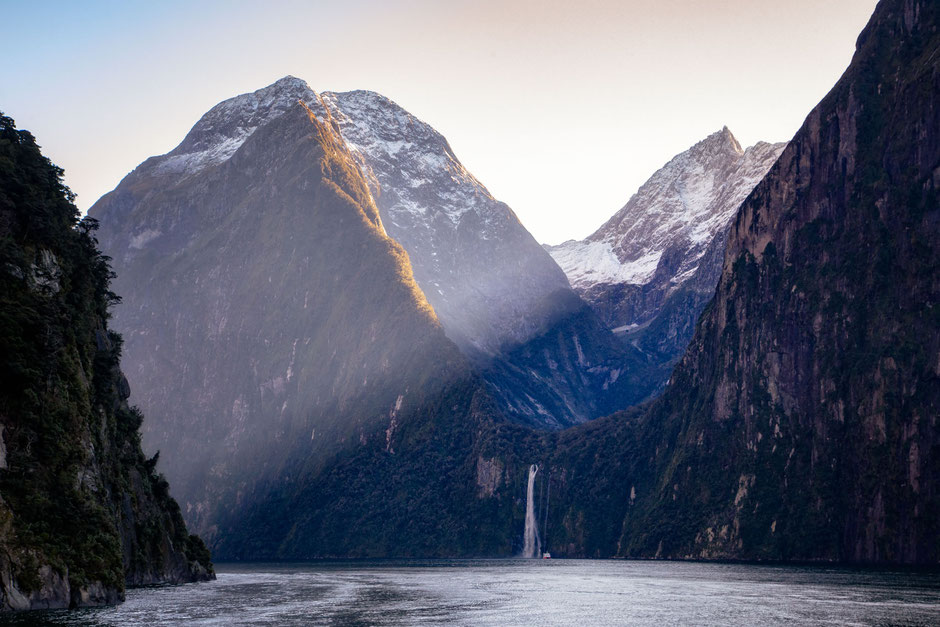 early morning light over Milford Sound in New Zealand. One week road trip itinerary around the South Island