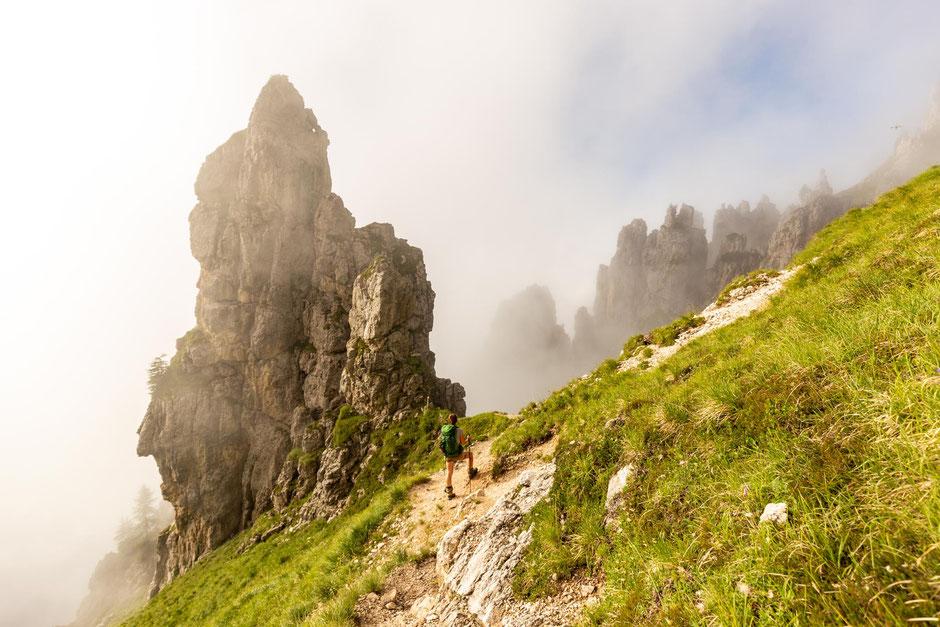 Hiking beneath Cima D'Oltro. The last day of crossing the Pale di San Martino range on Alta Via 2 in the Italian Dolomites