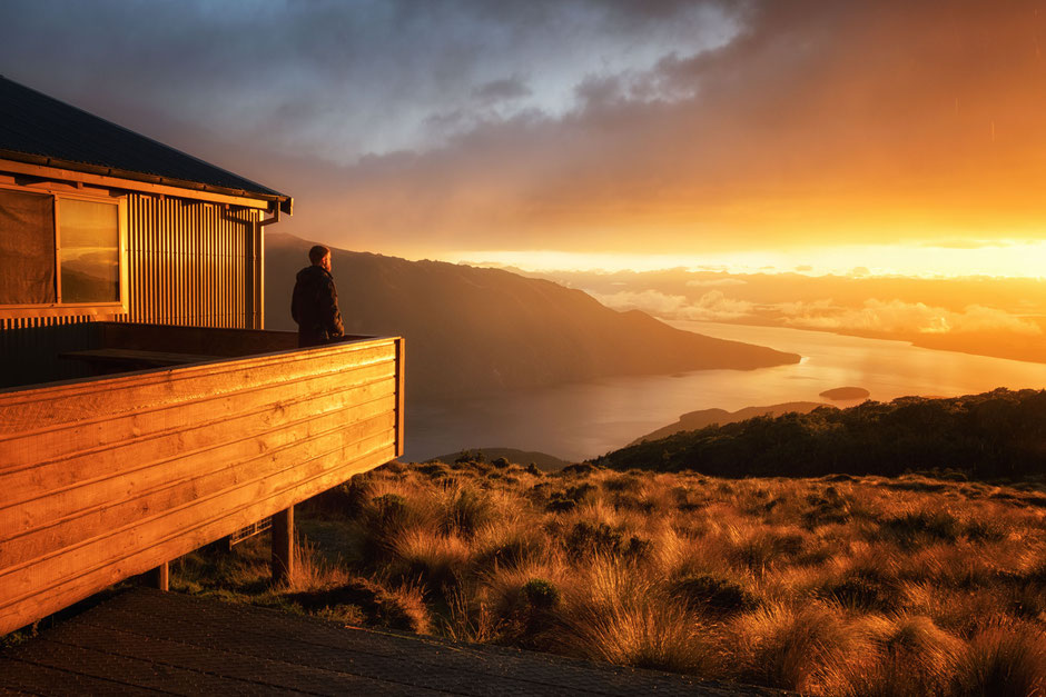 Sunrise from Luxmore Hut on the Kepler Track. Best backcountry huts in New Zealand