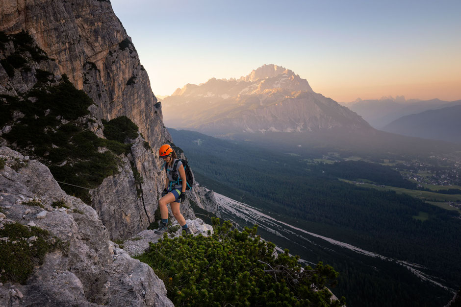 Climber along the via ferrata Michieli Strobel with Cortina D'Ampezzo and the Sorapiss Range in the background