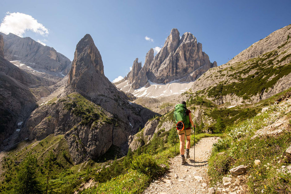 A hiker walking through Fiscalina valley towards Croda Dei Toni and Zsigmondy hut in the Italian Dolomites