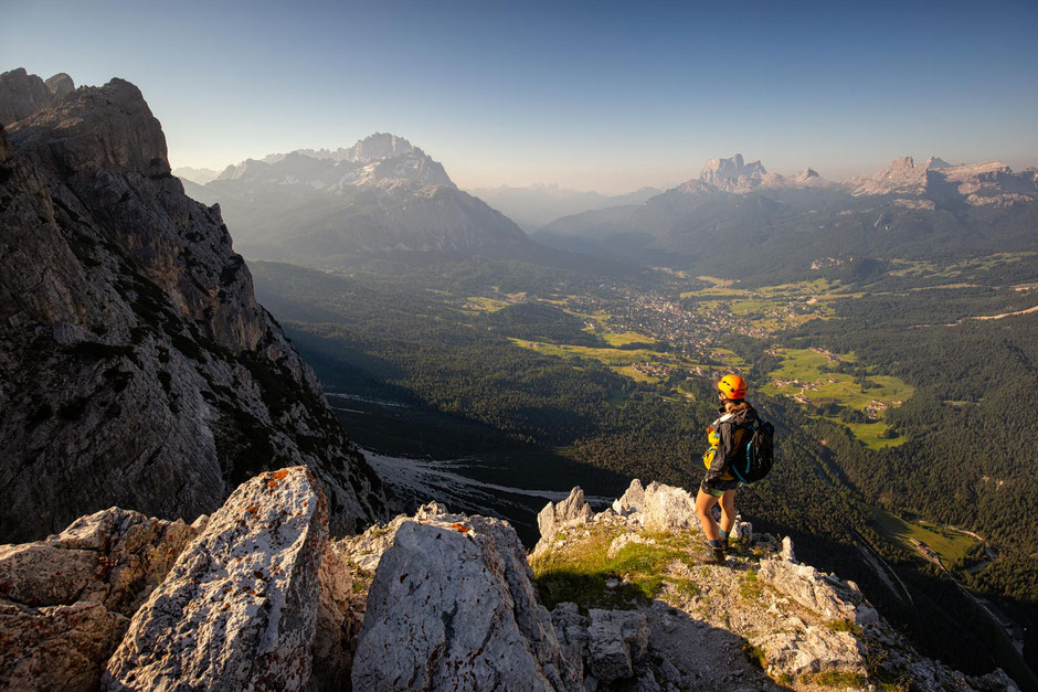 Climber on the Pomagnon ridgeline - the highest point on the via ferrata Michieli Strobel. The town of Cortina D'ampezzo can be seen in the background