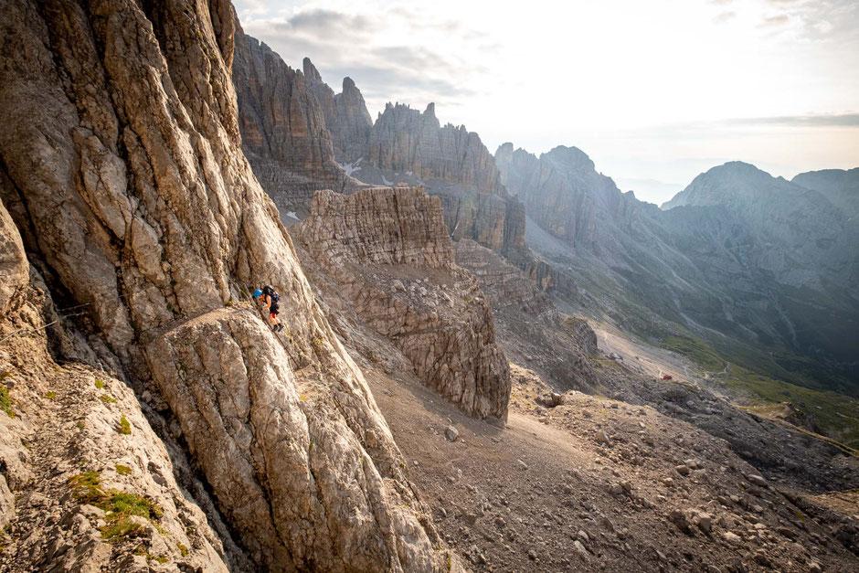 A person climbing the ladders on via ferrata Castiglioni in the Brenta Dolomites