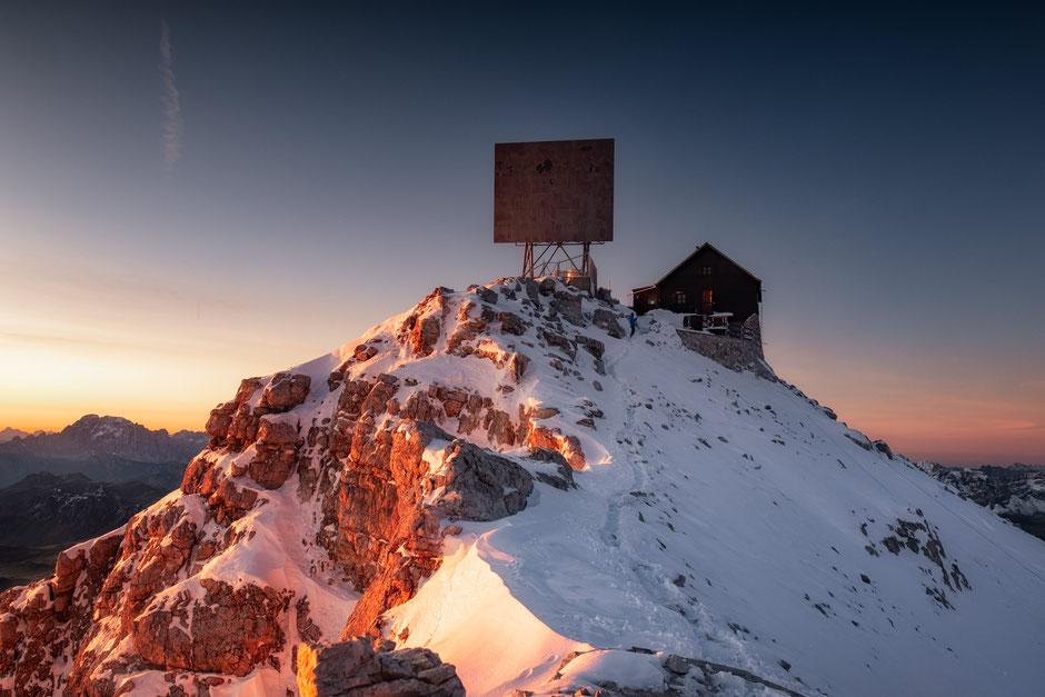Rifugio Capanna Fassa on the summit of Piz Boé at sunrise