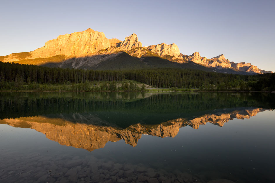 Mount Rundle reflecting in the Rundle forebay at sunrise